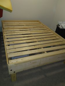 Wooden bed frame built with tools from the Tool Library