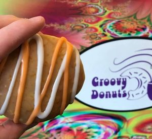 Groovy Donuts logo pictured next to a donut