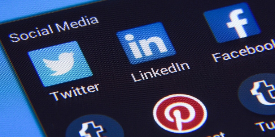Social media icons on a smart phone including twitter and linkedIn, tumblr and Pinterest