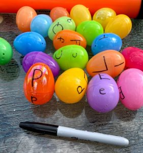 Plastic eggs with letters on them