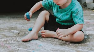 boy with chalk drawing