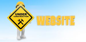 Cartoon rendering of construction worker holding sign that reads Website Under Construction