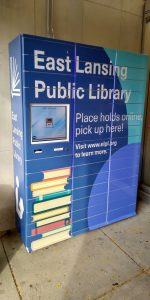 Library lockers for holds pickup, located outside the library's main entrance.