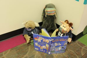 The Masked Bandit Book Club reading Click, Clack, Good Night by Doreen Cronin