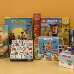 Kid prizes for the 2021 Summer Reading season, including books, DOTS kits, Settlers of Catan Jr, LEGO sets, and more