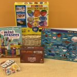 Teen prizes for the 2021 Summer Reading season, including mini erasers, an Exploding Kittens card game, a rock painting kit and an ocean life puzzle