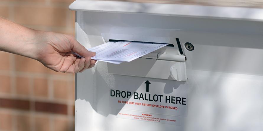 Arvada, Colorado, USA - October 23, 2016:  Hand delivering ballots to Jefferson County Drop Off Ballot Box