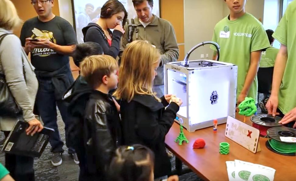 Kids using 3-D printer at Rinconada Library.