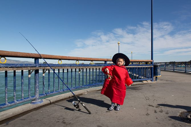 Jonathan is showing a crab his family caught, New Brighton Pier
