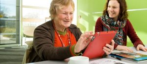 Older woman gets help with iPad