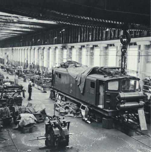 Christchurch to Lyttelton suburban Ec electric locomotive undergoing maintenance in the Addington Workshops [ca. 1960] CCL PhotoCD 11, IMG0054