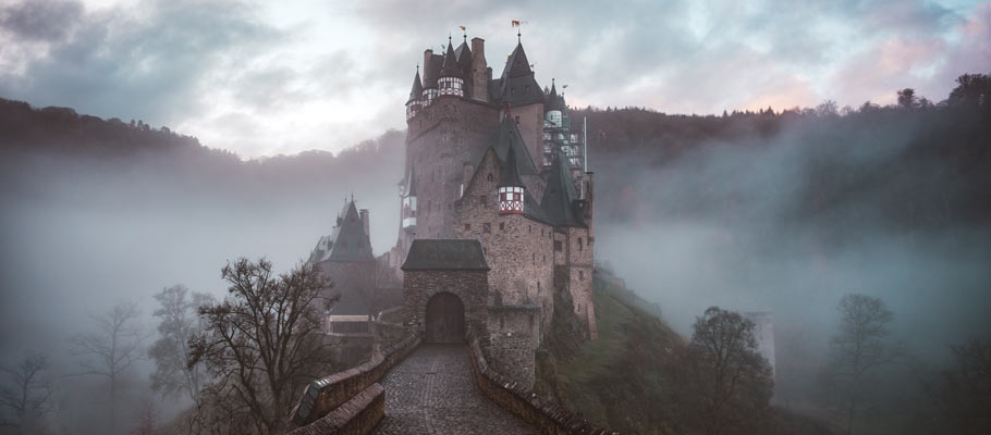 Photo of a castle surrounded with mist