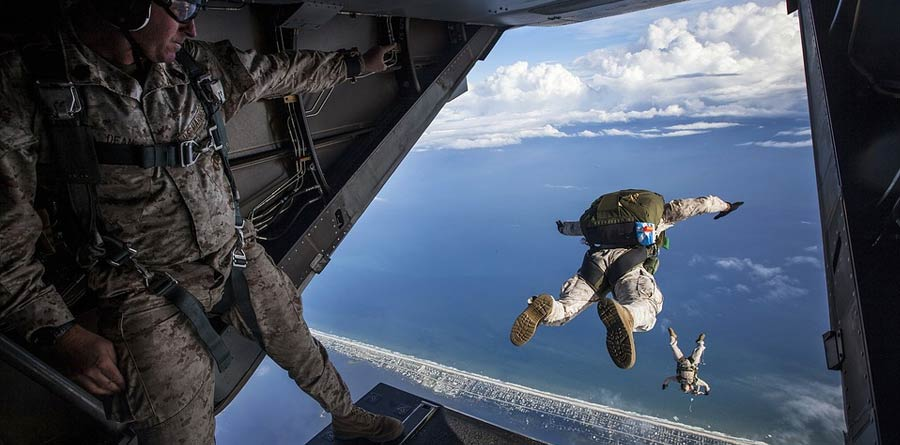 Photo of military men skydiving from an aircraft