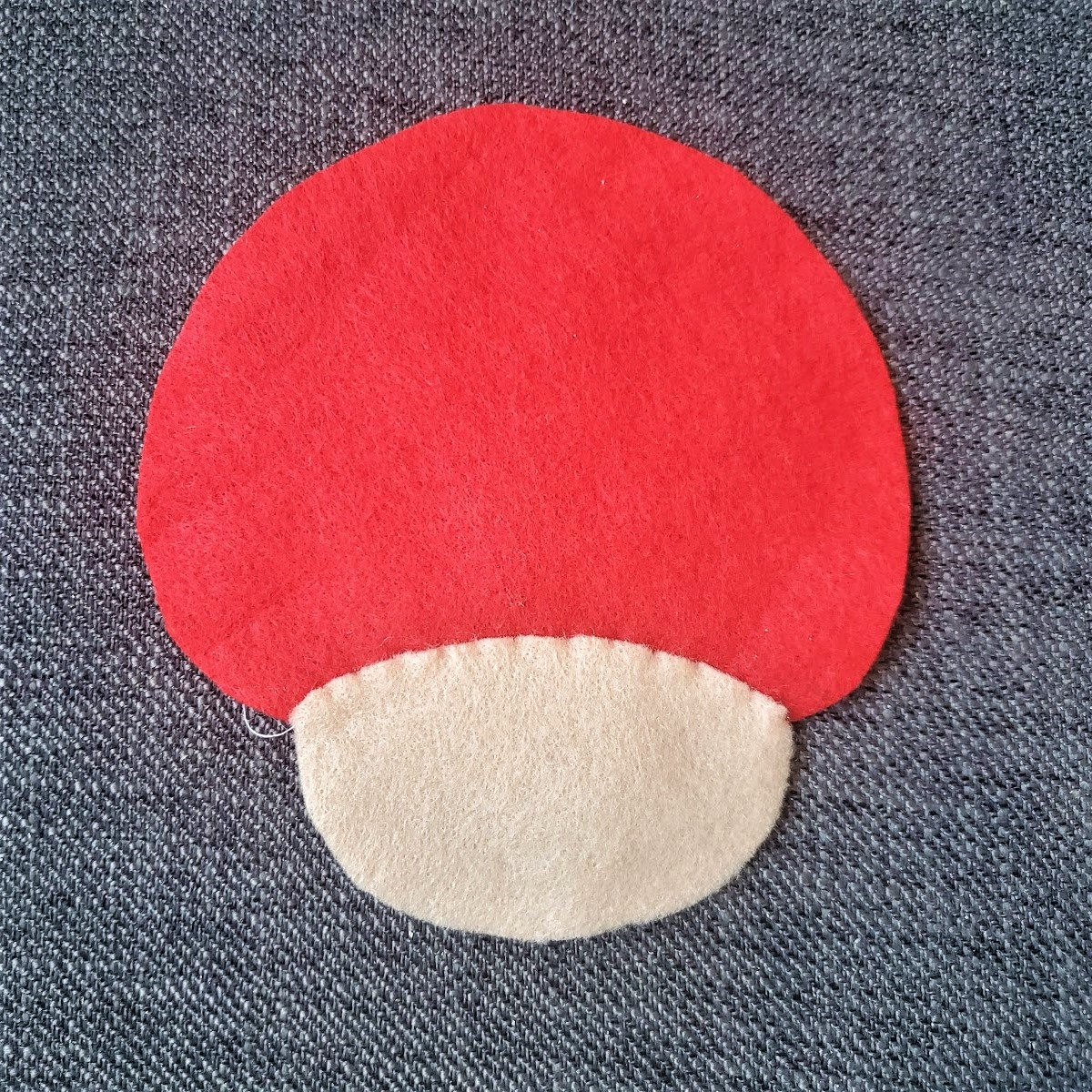 Image of the blank tan face piece and blank red mushroom back sewn together