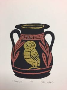 Image is of a Greek vase decorated with a golden owl and rust colored border and leaf desgins