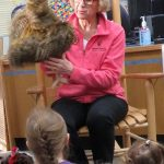 Miss Joanne holds a turkey puppet