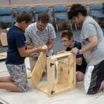 Library staff helping teens construct a Little Free Library to place out in the Xenia community.