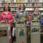 Winters-Bellbrook Community Library staff with decorated book carts
