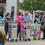 Winters-Bellbrook Community Library staff roll book carts in the Sugar Maple Festival Parade