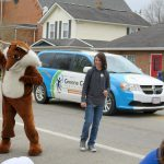 Booker the Fox waves to the crowd at the Sugar Maple Festival Parade