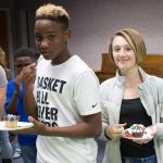 Teens hold decorated cupcakes