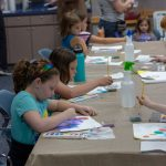 Kids paint with watercolors
