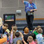 Jim Kleefled performs a magic trick