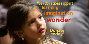"""Small girl with message: """"Your donations support learning, imagination, wonder. Donate today!"""""""
