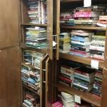 Donated Bookbike books in cupboards