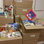 Donated Bookbike books in boxes, book covers