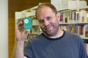 William hold his Ticket to Fun library card