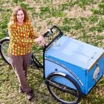 Librarian Karen Greene standing with Bookbike