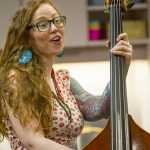 Photo of Georgia singing with her stand-up bass at rainbow storytime