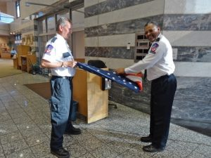 Guards folding the flag at Main Library