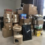 1,564 pounds of donations (stacks of boxes)