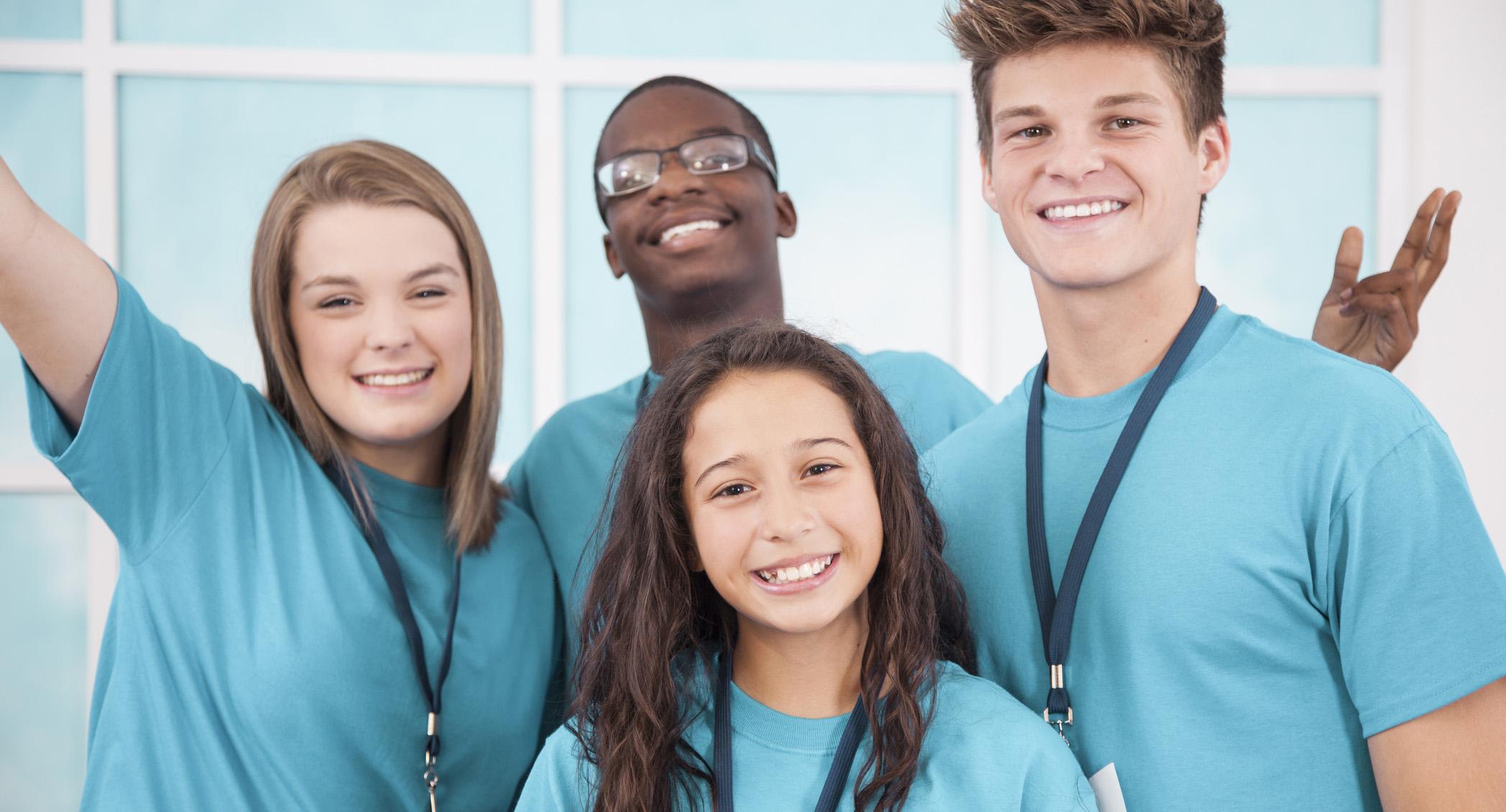 Diverse group of teenage volunteers.