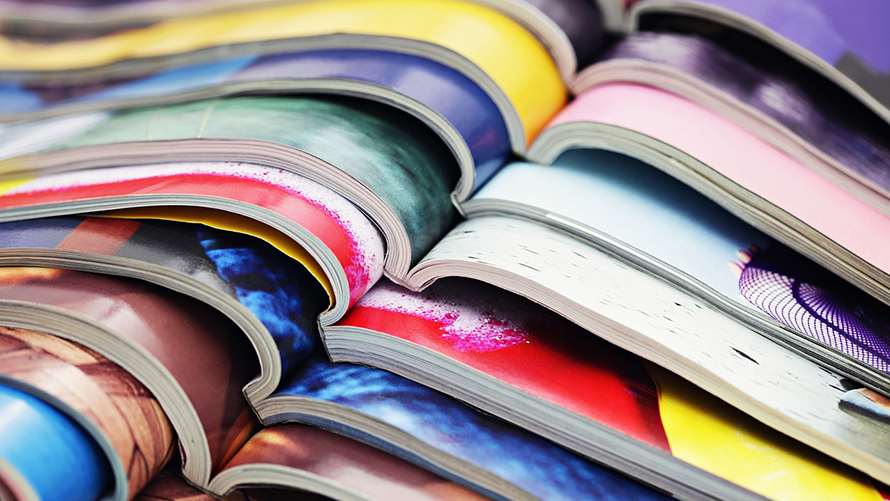 Magazines in a stack lying open