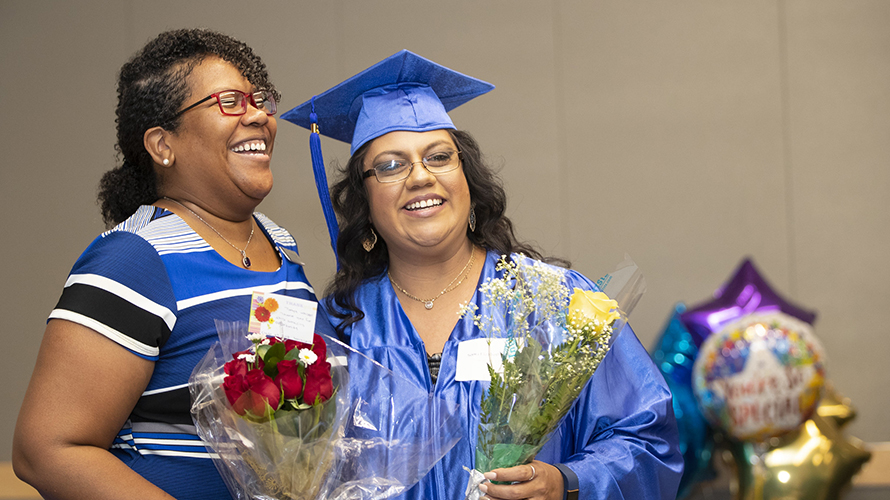 <p>Used for community impact plan 2020-2022 page priority 2  Graduates of Career Online High School attend their graduation ceremony at Flowing Wells Public Library.</p>