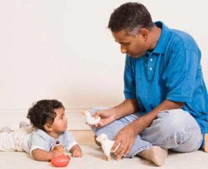 Father and toddler playing with toys