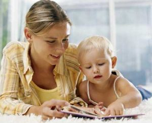 Mother and young child reading