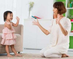 Mother and daughter enjoy a clapping game