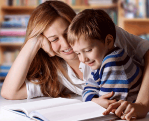 Mother and son happily reading a book