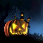 Scary Halloween jack-o-lantern in dark cemetary in front of castle