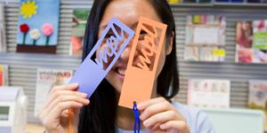 Girl holding MPL cutouts