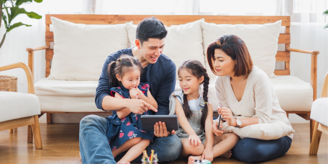 family reading using tablet