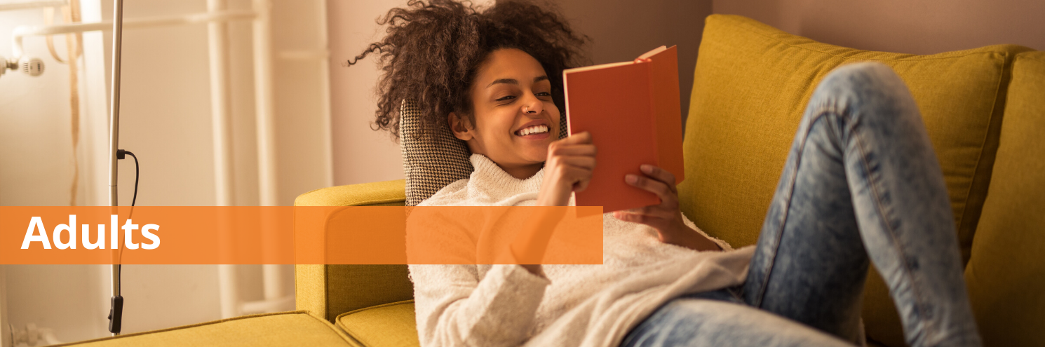 Woman lying on couch reading - Adult header