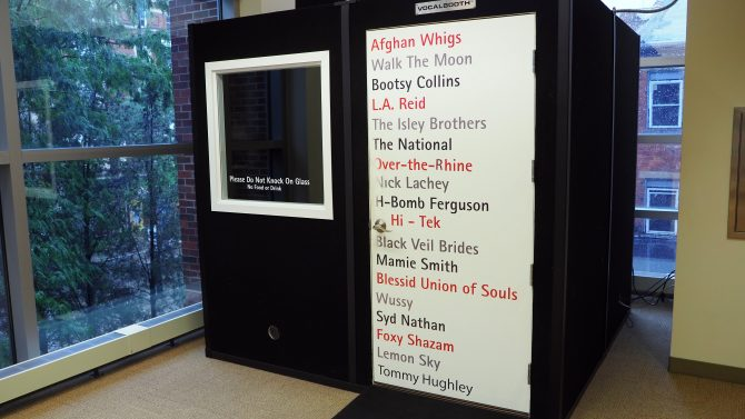 Photo of the outside of the audio recording booth featuring names of popular Cincinnati bands.