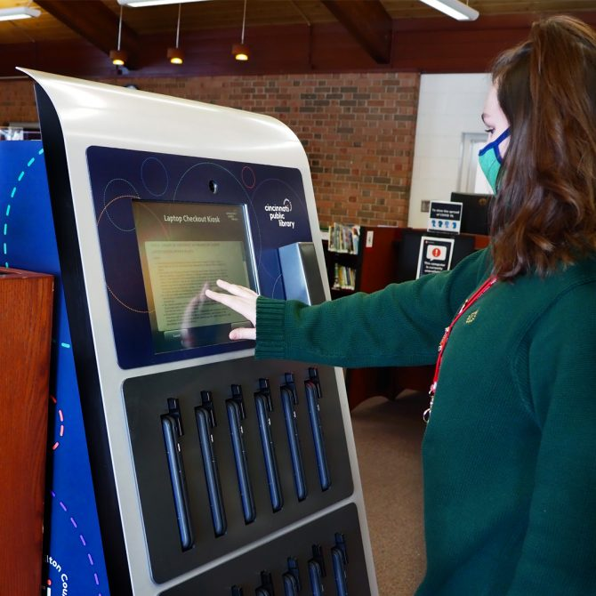 Woman using laptop kiosk at CHPL