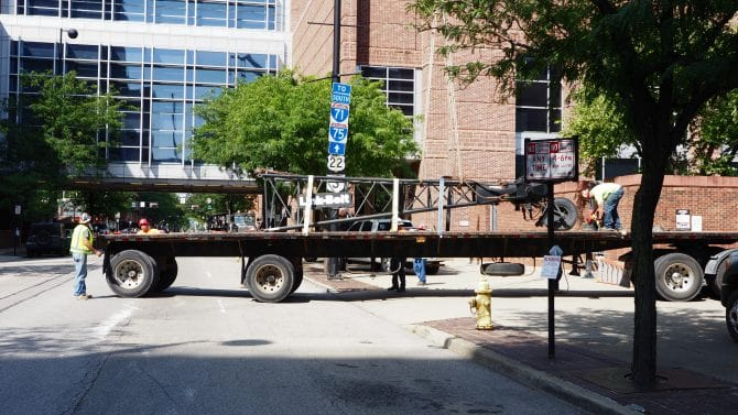 Part of the crane on a flatbed truck