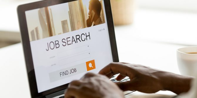 Person job searching on a laptop, Ebsco Job Career Accelerator
